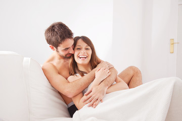 Young couple enjoying in bed