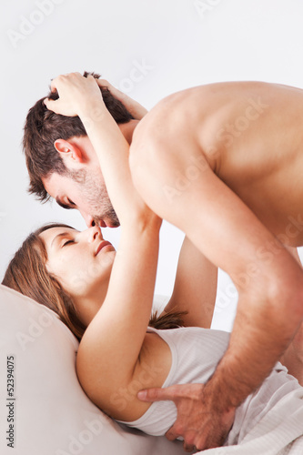 Lovely young couple in bed