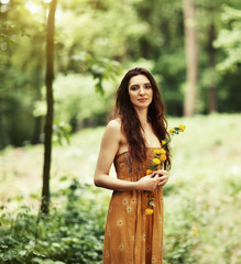 Portrait of a beautiful girl in the spring forest.