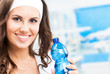 Woman with bottle of water, at fitness club