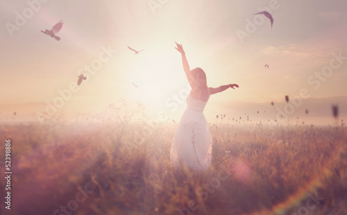 beautiful girl in a field at sunrise
