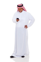 arab man reading email on smart phone
