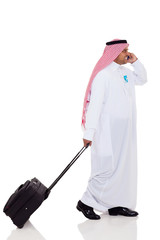arabian business traveler talking on cell phone