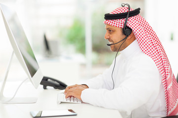 middle eastern businessman working on a computer