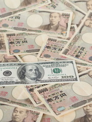 100 US dollar note isolated on Japanese yen note background