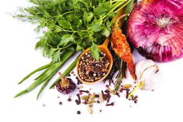 Various spices and herbs, onion and garlik