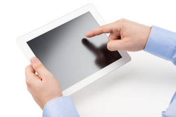 Man's hands are holding a tablet computer and points a finger at