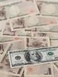 100 US dollar note isolated on Japanese yen note background