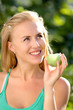 Portrait of young beautiful happy smiling woman with green apple