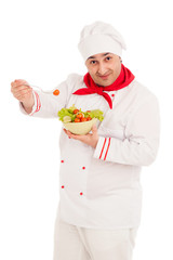 chef  holding dish with salad and fresh vegetables  wearing red