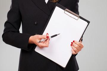 Blank paper in businesswoman hands