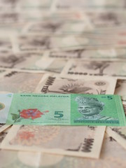 Malaysian ringgit note isolated on Japanese yen note background