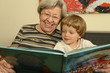 Grandma Reads Book With Child 2