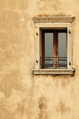 vintage wooden window on old wall