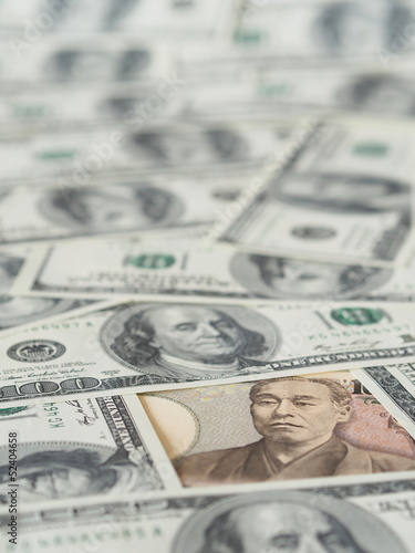 10000 Japanese yen note isolated on US dollar note background