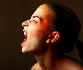 Scared young woman gesturing on black background