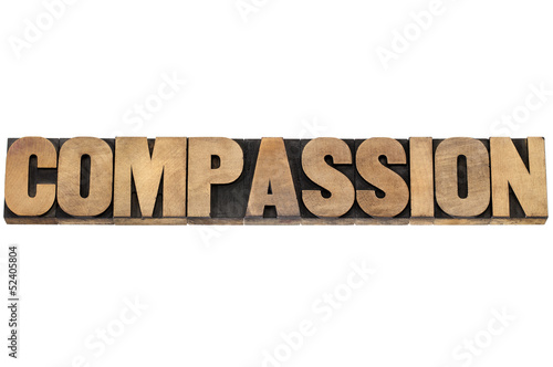 compassion word in wood type
