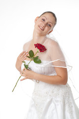 Bride in white with red rose