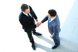 Fototapety Top view of a two businessman shaking hands