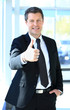 Businessman showing OK sign with his thumb up.