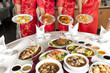 Chinese food, full rounded table of Chinese food with waitress