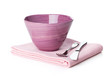 Salad bowl and silverware over kitchen towel