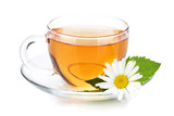 Cup of tea with mint leaves and chamomile flower