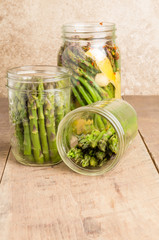 Jars of asparagus being canned
