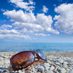sun glasses on a seashore