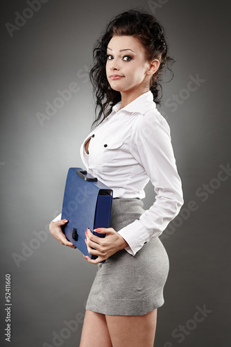 Beautiful businesswoman holding a briefcase