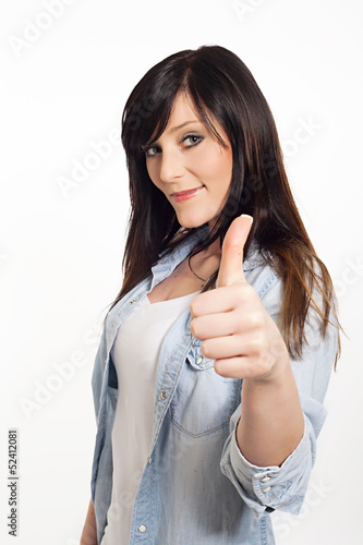 portrait of a beautiful young woman thumbs up