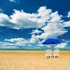 Pair of sun loungers and a beach umbrella