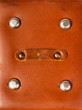 detail of old red leather briefcase closeup