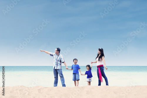 Asian family enjoy holiday at beach