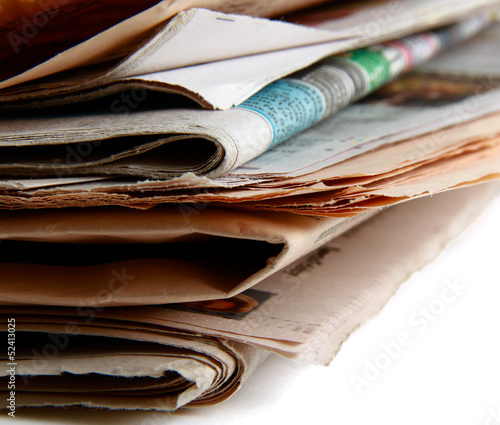 Stack of newspapers on the desk