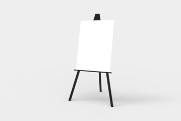 A black easel with a blank white canvas on it.