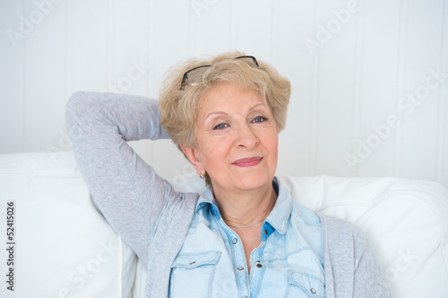 Smiling happy senior woman relaxing at home