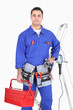 Skillful electrician with equipment on white background
