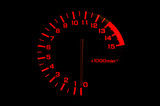 automobile tachometer on black background