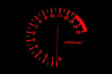 automobile tachometer on black background