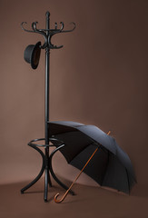 standing peg with hat and open umbrella