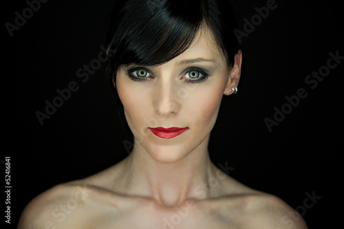 Portrait of a bautiful young woman with red lipstick
