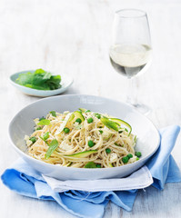 Pasta with olive oil and green vegetables with glass of wine