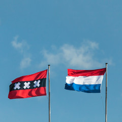 The Dutch national flag and the official flag of Amsterdam