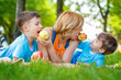 Family eating apple in the nature