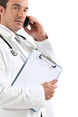Doctor on phone with clipboard