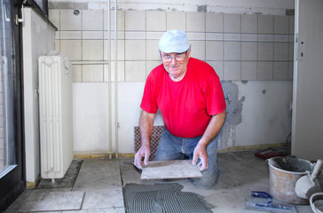 Senior man with ceramics, interior decoration