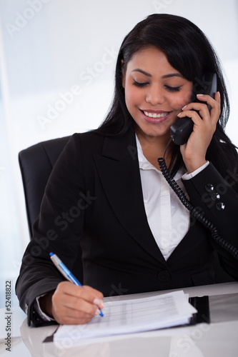 Young Woman Writing Message From Phone