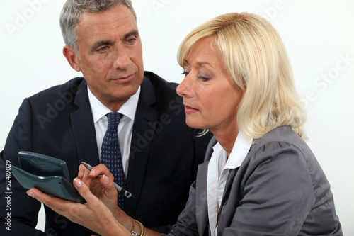 Senior business couple going over finances