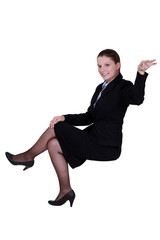 A businesswoman making a gesture.